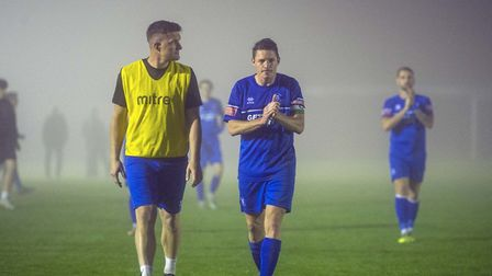 Ollie Hughes, right, and team-mate Ben Mayhew trudge off the pitch after Tuesday night's match was c