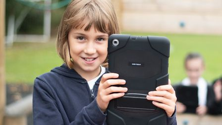 Pupils using the new ipads to experiment with photography. Picture: SARAH LUCY BROWN
