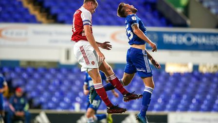 Arsenal U21 skipper Mark McGuinness and Aaron Drinan contest a high ball in the EFL Trophy. Photo: S
