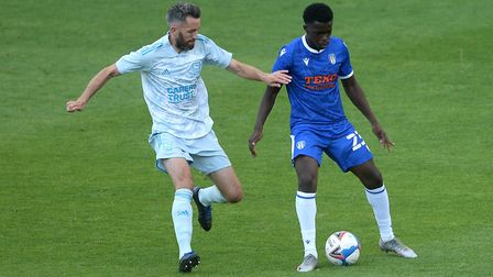 Ipswich Town's Cole Skuse closes down Kwame Poku of Colchester United Picture: RICHARD BLAXHALL
