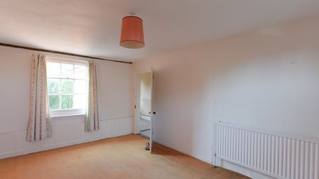 This three-storey townhouse in Halesworth is in need of a total renovation. Picture: Clarke & Simpso