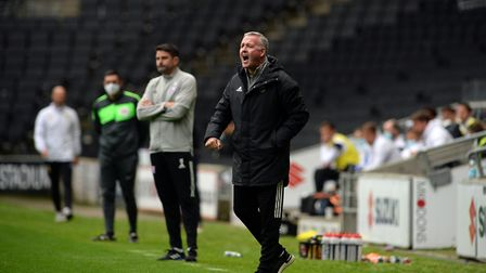 Ipswich Manager Paul Lambert urges his players on late in the second half at MK Dons whilst they are