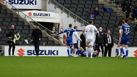 Ipswich captain Luke Chambers is left floored at MK Dons during the first half. Picture Pagepix Ltd