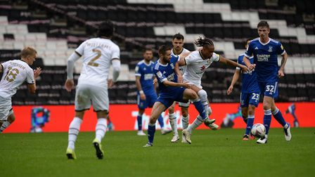 Gwion Edwards battling at MK Dons. Picture Pagepix Ltd