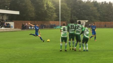 Bury Town left-back Will Gardner shapes to take a free-kick durng the FA Cup tie against Waltham Abb