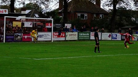 Callum Bennett slots home a last-minute penalty to rescue a point for Felixstowe & Walton United in