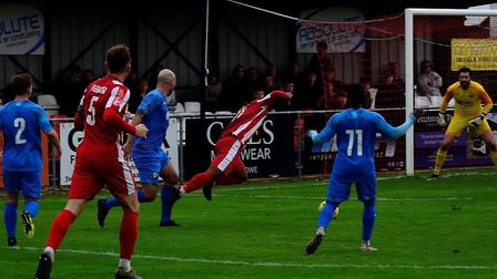 Felixstowe & Walton United are awarded a late penalty against Coggeshall Town. Picture: DAVE FRANCIS
