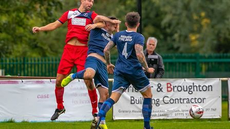 Woodbridge Town's Mark Ray clashes with Kris Rose during the 2-1 defeat at Hadleigh UNited. Picture: