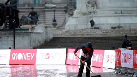 A steward sweeps the course on the spectator-free, closed route of the 2020 London Marathon. Picture