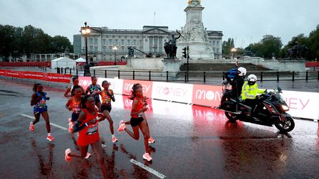 Action from a very wet and cold elite women's race. Picture: PA
