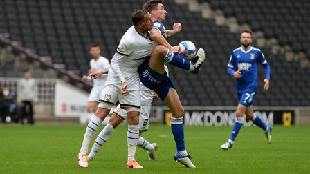 Old Hawkins under pressure from Richard Keogh during the first half at MK Dons. Picture Pagepix Ltd