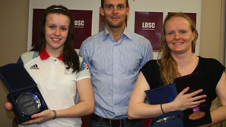 Paralympic swimmers Amy Marren (L) and Susie Rodgers (R) are joined by Mike Gliddon of leisure compa