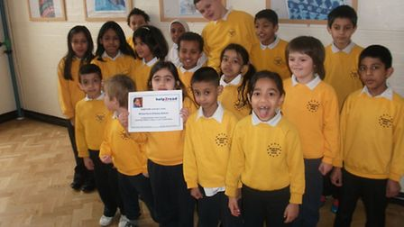 Pupils from William Davis with their certificate from South African charity help2read.