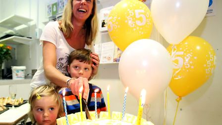 Mum Claire Saez, with five-year-old Jake and his little sister. Chloe, cut the birthday cake.