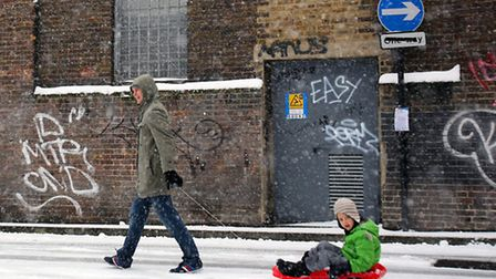 Wojclech, 33, and Karol Lerrka, 6, make the most of the snowy weather