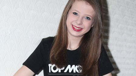 Michelle Neil, 16, has got through to the grand finale of a modelling competition.