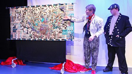 The Phoenix tapestry is unveiled at the opening of the new building at Phoenix School