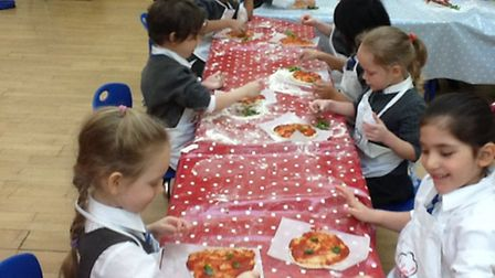 Pupils at CET Primary School in Mile End make healthy pizzas as part of a cookery lesson to celebrat
