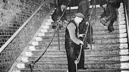 1943, day after tragedy... staircase of death is repaired and safety railings belatedly installed