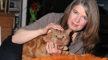 Cat sitter Barbara Read is glad to be reunited with ginger-haired Brandy after he escaped from his n