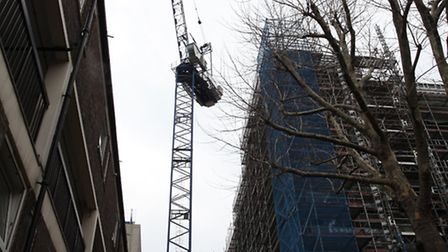 A crane at the building site in Vernon Road, Bow, where a 51-year-old man died.