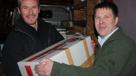 Bishop of Stepney (left) and Dean of Tower Hamlets load up school supplies for Syrian children