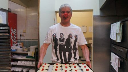 Brian Boulter prepares to bake a tray of pies - each sporting a red pastry nose - at Eastenders Pie