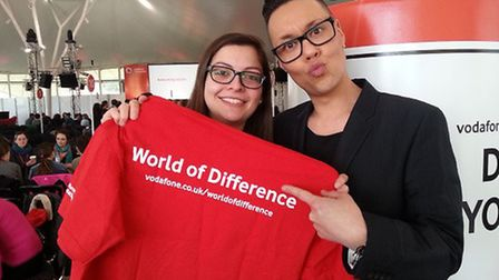Gok Wan helps launch the Vodaphone World of Difference charity funding initative with a volunteer