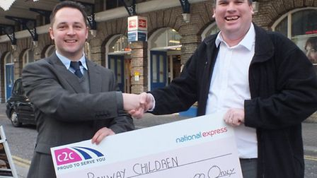 Railway Children charity's Dave Ellis [left] receives cheque from train-driver Geoff Powell