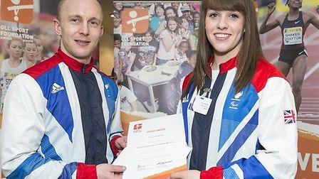 Tower Hamlets athlete Amy Marren with GLL ambassador Ben Quilter after successfully securing a grant