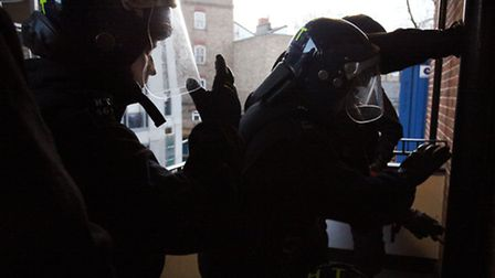 Police officers carry out dawn raids in Tower Hamlets