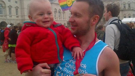 Little Jack Finan greeted by his uncle Kevin who just completed Sunday's marathon