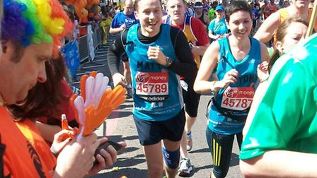 Husband-and-wife team Matt and Bryony Skinner running for Richard House, passing the charity's water