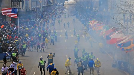 People react as an explosion goes off near the finish line of the 2013 Boston Marathon. Photo: AP Ph