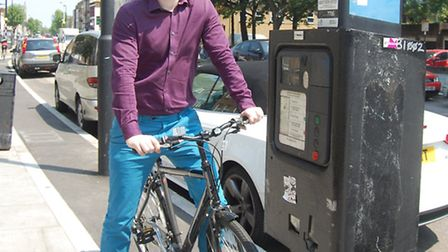 Cllr John Pierce tries to navigate the parking meter along the route before it was removed
