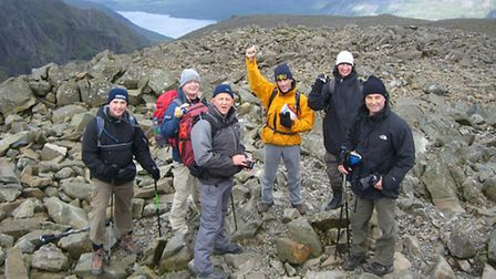 Firefighters from Bethnal Green fire station at the top of Scafell Pike during the Three Peaks chall