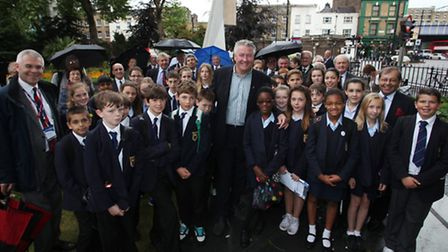 Tommy Walsh (centre) with Parmiter's pupils at Stairway to Heaven Memorial in Bethnal Green Gardens