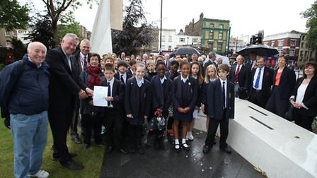 Parmiter's School present a £1,000 cheque to Tommy Walsh for the Stairway to Heaven Memorial Trust a