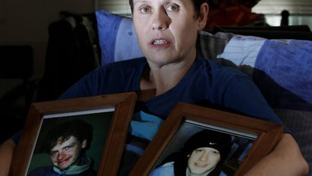Anne Stockdale, pictured with photographs of Wayne after his murder