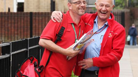 Postman Peter Cecil, right, has a laugh with work colleague John Warren, as he is retiring after 50