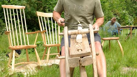 Ben Willis demonstrates an old wood shaving craft at Tower Hamlets Cemetery Park Woodland Spring Fes