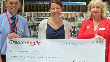 Rail safety director Michael Moy (left) hands cheque to Samaritans' Rachel Kirby-Ride (centre) with