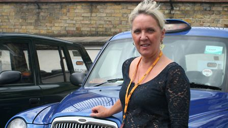Tracy Mitchell with her blue cab that she picked the Middletons up in after the birth of Prince Geor