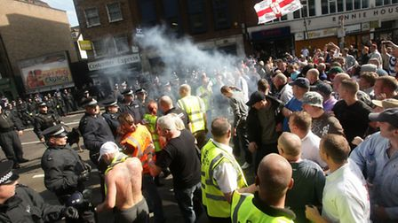 A fire cracker is let off during an English Defence League (EDL) demonstration at Aldgate Station in