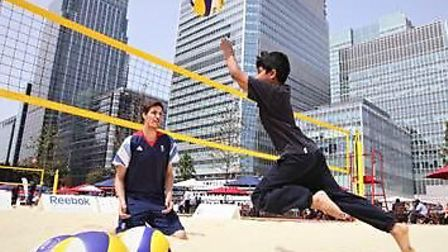 A youngster plays beach voleyball withi GB sitting volleyball captain Rob Richardson