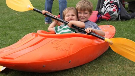 Brothers Idor (left) and Bryn Dickinson learning to canoe at Mile End carnival