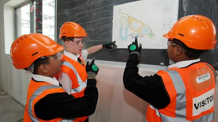 Pupils Ricky Hall, left, Joynul Hussain, and Rajel Ullah study the map of the new Bow School.