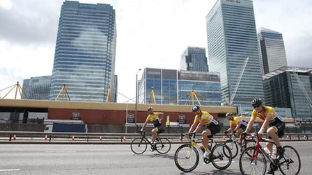Cyclists at the Prudential RideLondon Surrey 100 on its way through Aspen Way, Poplar.