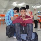 Ajmol Alom, 16, at Belfast airport following a visit to Northern Ireland with his school.