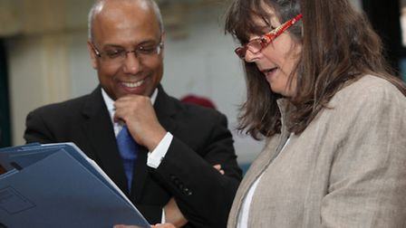 Smiling Mayor Lutfur Rahman is delighted when head teacher Esther Holland shows him A-level results
